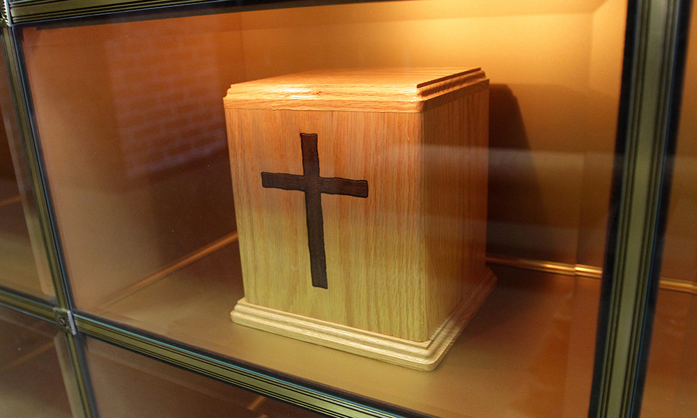 What does the Church say about how cremated remains should be handled?